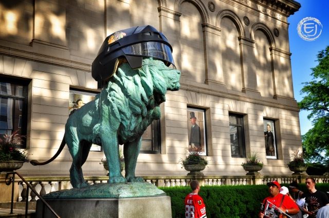 1.The early morning sun reflects off of the building across the street illuminating the Art Institute and one of the iconic lion statues that happens to be wearing a Blackhawks helmet.